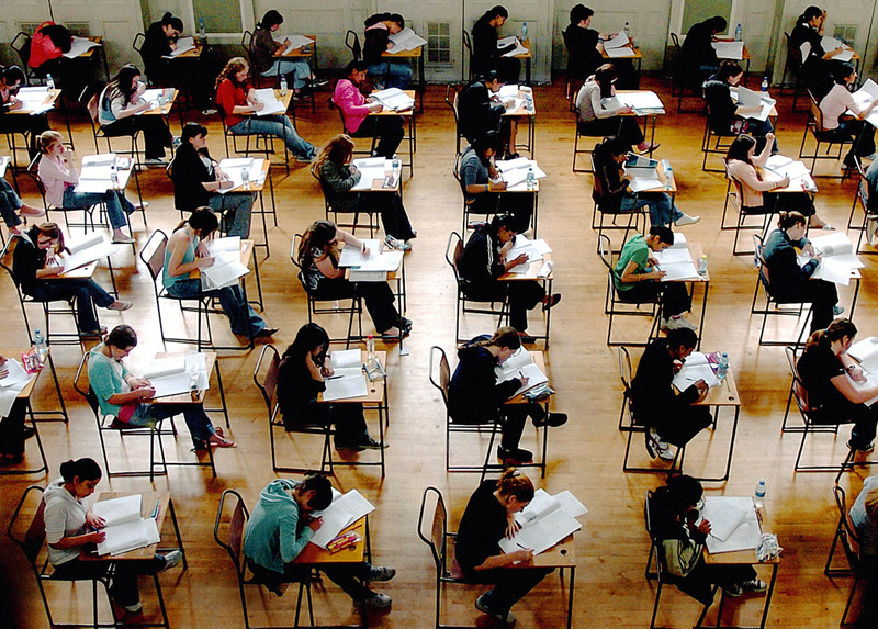 File photo dated 10/06/05 of school exams in progress. PRESS ASSOCIATION Photo. Issue date: Monday January 5, 2009. The education gap between children from England's richest and poorest areas is widening, according to official figures obtained by the Conservatives. In 2007, the proportion of children achieving five good GCSEs, including English and maths, in schools where more than half of the pupils were eligible for free school meals was 13%, a drop from 14% in 2006. See PA story EDUCATION Gap. Photo credit should read: Rui Vieira/PA Wire